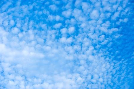 indigo: White clouds on blue sky.