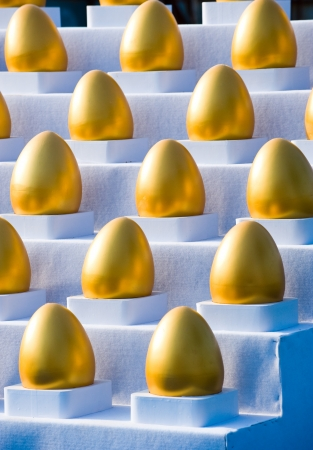 collects: many gold eggs on a white stairs. Stock Photo