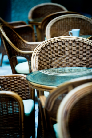part of empty lounge, tables and chairs. photo