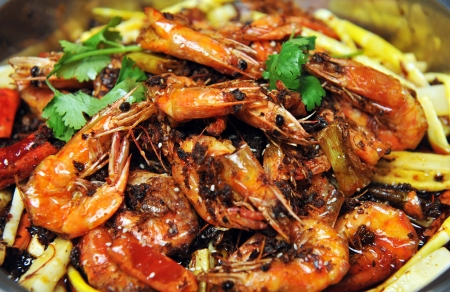 piquancy: group of cooked orange shrimp with piquancy. Chinese food.