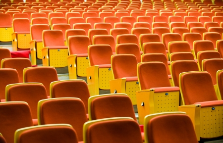 ticketing: A line of red theater chairs.