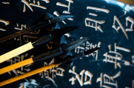 Chinese calligraphy and four chinese calligraphic brushes.