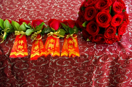 Chinese bride and groom with wedding bouquet, the single rose with Chinese character bride groom etc, without any copyright.  photo