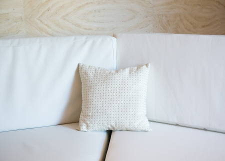 white decorative pillow on a contemporary sofa. Stock Photo - 13829969