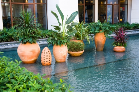 architectural style: Pot with  plants in Balinese architectural style.