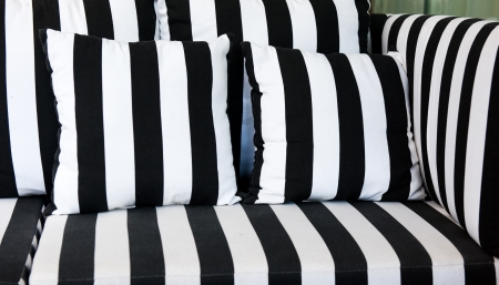 detail of sofa and pillows with black and white stripe. 