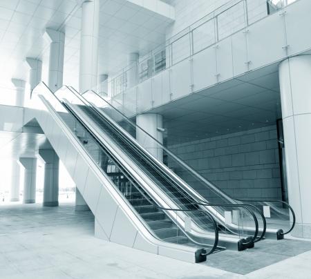 mall interior: Two escalators in new modern building.