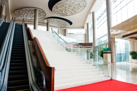 view of a staircase in a shop: Two escalators and stairs in new modern building.  Editorial