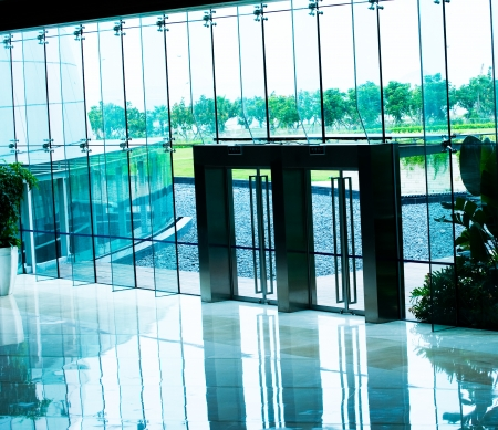 foyer: The glass doors of modern building Editorial