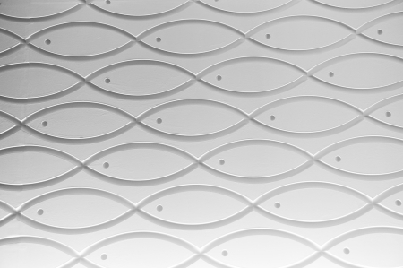pewter: clean wall detail with many pattern of fish.  Stock Photo