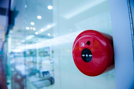 fire safety: fire alarm on the wall of shopping center.