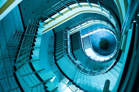 top angle view: wide-angle view down a spiral stairs from the viewing platform at the highest point