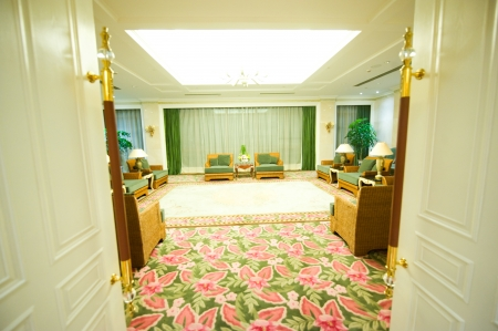 white doors mark the entrance to a luxurious conference room.