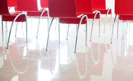 business lounge: red chairs in ordinary empty waiting room.