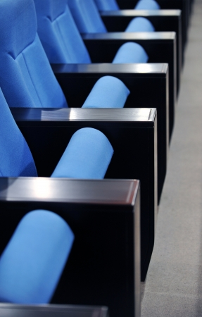 line lines luxury meeting: a line of blue theater chairs. Stock Photo