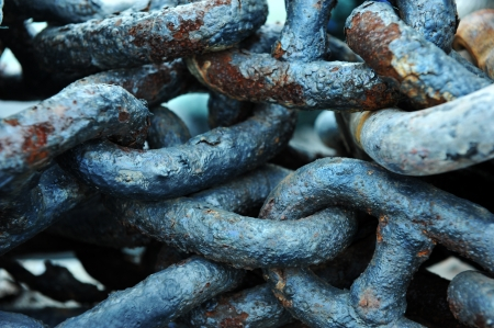 Pile of rusted chains at a boatyard. photo
