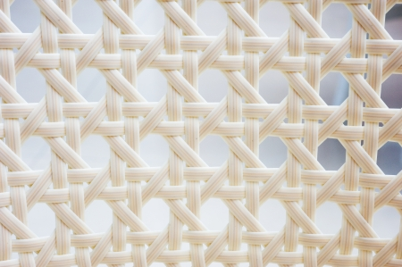 A chair white white basket weave pattern. photo