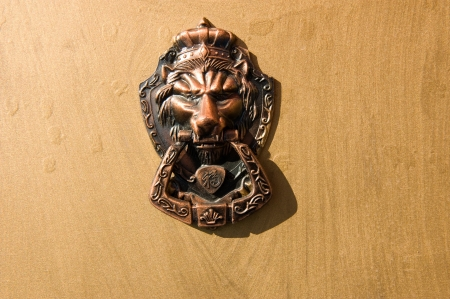 A Chinese traditional copper knocker. photo