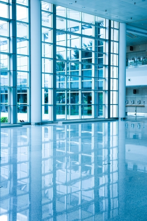 glass door: Modern architecture of large business conference center with blue tone.