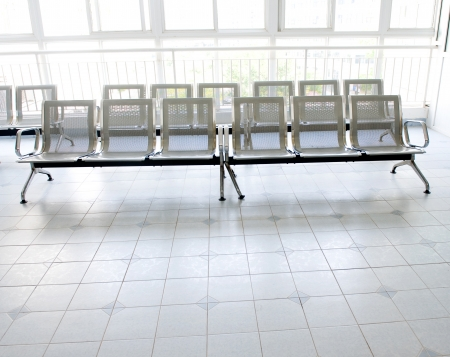 Hospital waiting room with empty chairs. photo