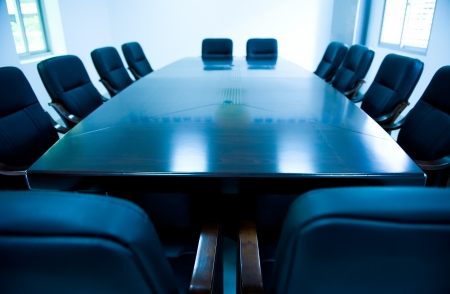 director's chair: blue tone of empty boardroom or meeting room.