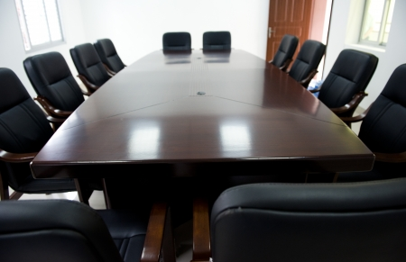 conference room table: empty boardroom or meeting room.  Editorial