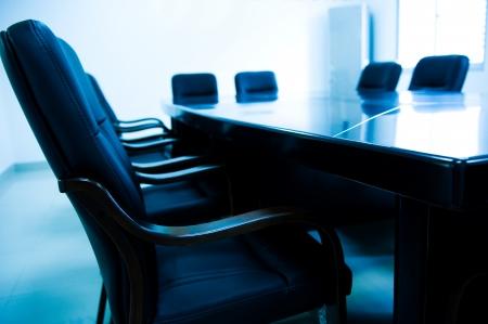 Boardroom meeting: blue tone of empty boardroom or meeting room.