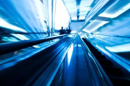 Two ways escalator in blue tone. ( motion blur) Editorial