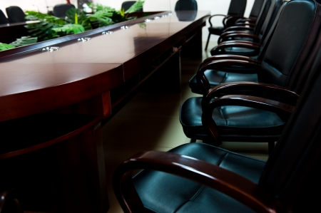 director's chair: empty boardroom or meeting room.  Stock Photo