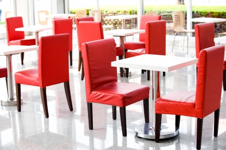 red chair: office bar with many chairs and table.