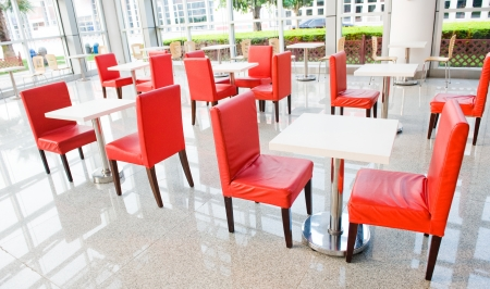 canteen: office bar with many chairs and table.