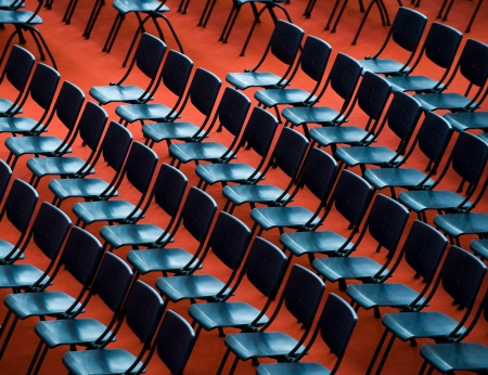 convention hall: top view of many blue chairs in an audience auditorium.