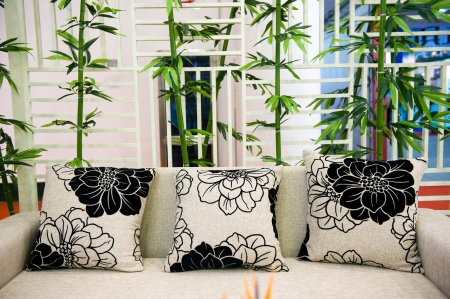 Pillows on sofa with the background of bamboo.