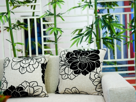 Pillows on sofa with the background of bamboo.   photo