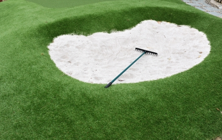 rake: small golf sand bunkers for exercise. Stock Photo