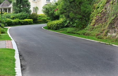 curve road nearby the house. Stock Photo - 13827235