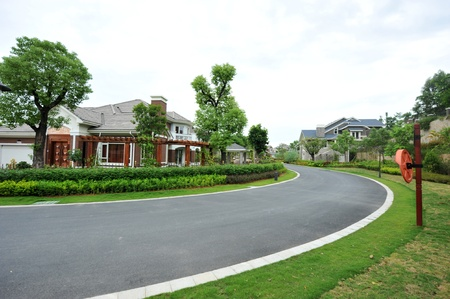 curve road nearby the house. Stock Photo - 13861042