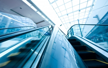 Two ways escalator in blue tone.  ( motion blur)