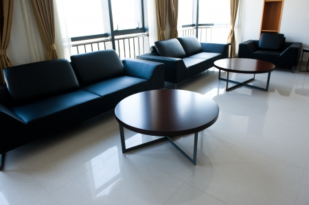 contemporary lounge with sofa and tables.