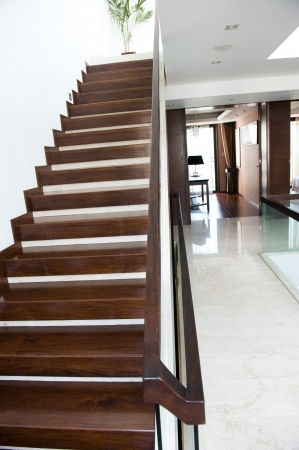 A gently wooden staircase inside a large expensive Chinese home.