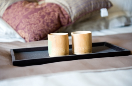 cups on a bed in a hotel room. photo
