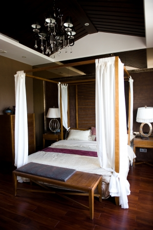 poster bed: Oriental style resort bedroom in China. Editorial