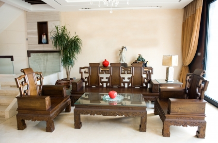 Living room furnished with antique Chinese rosewood furniture.