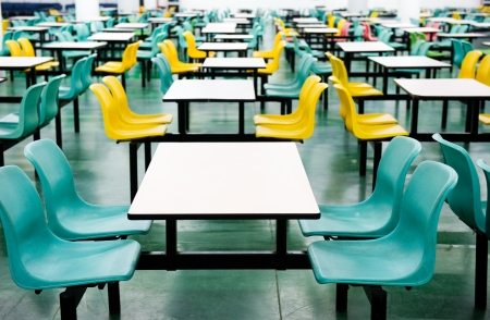 prepared food: Plastic chairs and tables at fast food restaurant