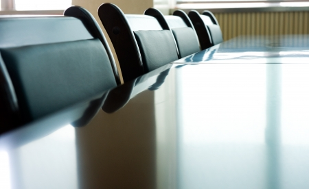 board room: Head office boardroom with leather chairs. Stock Photo