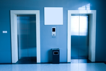 A pair lifts in a hotel hall, blue tone  Stock Photo - 13861007