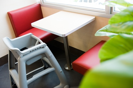 Baby eating chair in a restaurant. Stock Photo - 13824752