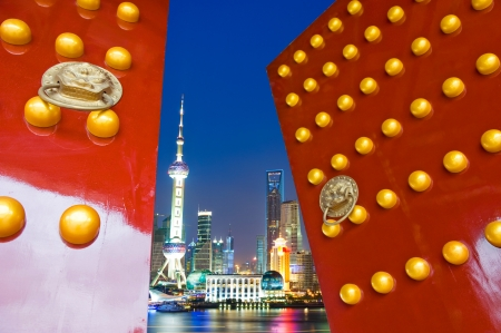 east gate: Red Chinese door open , with the background of shanghai skyline, night scene.  Stock Photo