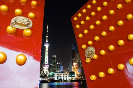 open gate: Red Chinese door open , with the background of shanghai skyline, night scene.  Stock Photo