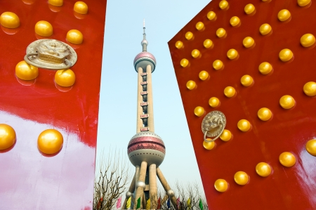 Red Chinese door open , with the background of the Oriental Pearl Tower, Shanghai.